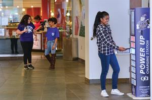 Celine Gragasin ditches her phone at the lockable charging station before dining  in the union with friends Scarleth Lopez, background left, and student body  vice president Star Jackson.