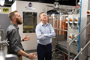 Colorado Governor John Hickenlooper, a craft brewer himself, gets a tour of Ramskeller Pub in Colorado State's Lory Student Center from Jeff Callaway, left, associate director of the university's fermentation science and technology program.