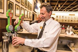 At Purdue Memorial Union's 1869 Tap Room, student union finance director Brad Pape puts his state server's license to work pouring Purdue University's first officially branded beer, Boiler Gold American Golden Ale, during a special event.